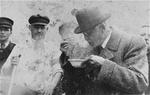 Chaim Rumkowski tasting soup made at a public kitchen in the Lódz ghetto, date unknown