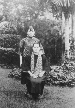 Song Qingling (seated) and Song Meiling (standing), circa late 1910s or early 1920s