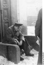 Albert Speer sitting on doorsteps, 22 Dec 1942