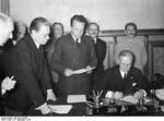 Ribbentrop signing the German-Soviet non-aggression pact, Moscow, Russia, 23 Aug 1939, photo 1 of 3; Shaposhnikov, Molotov, and Stalin in back row