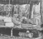 General Joseph Stilwell reading a letter at the Forward Echelon Headquarters, Taihpa Ga, Burma, 23 Feb 1944