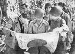 General Stilwell inspecting a recently captured Japanese flag, 1942
