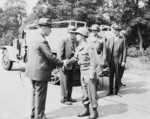 Major General Frank Parks, General George Patton, Colonel W. H. Kyle, J. J. McCloy, H. H. Bundy, and US Secretary of War Henry Stimson, reviewing US 2nd Armored Division, Berlin, Germany, 20 Jul 1945, photo 4 of 4
