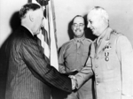 US Secretary of War Henry Stimson awarding Lieutenant General Delos Emmons the Distinguished Service Medal, Jul 1943; Brigadier General H. B. Lewis in background
