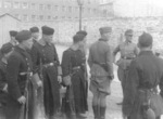 Jürgen Stroop with Polish or Ukrainian policemen in Warsaw, Poland during the ghetto uprising, May 1943