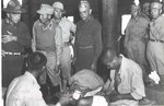 US General Daniel Sultan, Chinese General Sun Liren, and medical doctor Gordon Seagrave visiting wounded Chinese troops in a field hospital, Burma, 1940s