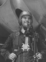 Tibbets posing in front of an aircraft in full pilot gear, date unknown