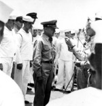 Commander Arnold True, commanding officer of USS Hammann during Battle of Midway, receiving Navy Cross award from William Halsey, Oct 1942