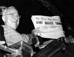 Truman holding a copy of Chicago Tribune that mistakenly anticipated his defeat in the 1948 election by Thomas Dewey, Union Station, St. Louis, Missouri, United States, 3 Nov 1948, photo 1 of 2