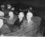 US President Harry Truman, Secretary of State James Byrnes, and Ambassador to Belgium Charles Sawyer in a car, Antwerp, Belgium, 15 Jul 1945, photo 1 of 2