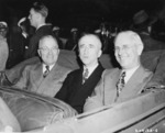 US President Harry Truman, Secretary of State James Byrnes, and Ambassador to Belgium Charles Sawyer in a car, Antwerp, Belgium, 15 Jul 1945, photo 2 of 2