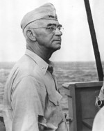 Rear Admiral Richmond Turner aboard USS Rocky Mount off Kwajalein, Marshall Islands, 18 Feb 1944