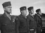 MGen A. Vandegrift, Col M Edson, 2Lt M. Paige, and Plt. Sgt. J. Basilone at US 1st Marine Division Medal of Honor ceremony, Balcombe, Australia, 21 May 1943, photo 1 of 2