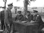Soviet generals Aleksandr Vasilevsky and Ivan Chernyakhovsky speaking with surrendered German Major General Alfons Hitter, Vitebsk, Byelorussia, 28 Jun 1944