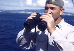 Lieutenant Howard W. Whalen with binoculars, circa 1945