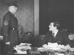 US Ambassador to the UK John Winant speaking to USMC Platoon Sergeant John Allen, Jr. at Court of St. James