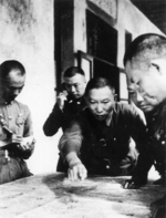 Xue Yue studying a map with his staff officers, date unknown