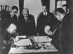Manchukuo Prime Minister Zheng Xiaoxu and Japanese Ambassador Nobuyoshi Muto signing the Japan-Manchukuo Protocol, Xinjing, Manchukuo (now Changchun, China), 15 Sep 1932