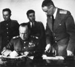 Georgi Zhukov signing the German surrender document, Karlshorst, Berlin, Germany, 8 May 1945, photo 2 of 2