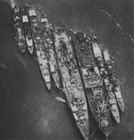 Destroyer Harusame, a minesweeper, destroyer Akizuki, a destroyer, repair ship Akashi, seaplane tender Sanyo Maru, another destroyer, and a patrol boat at Truk, Caroline Islands, Feb 1943