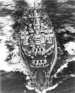 Aerial bow view of US battleship Alabama underway, 1945; note upgraded SC-1 Seahawks float planes on her catapults