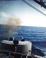 Alaska fired her 5-inch gun during gunnery practice, 5 Feb 1945