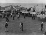 FM-1 aircraft having crashed into several TBF aircraft while landing on the flight deck of USS Coral Sea, 11 Oct 1943, photo 1 of 3