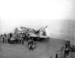 FM-1 aircraft having crashed into several TBF aircraft while landing on the flight deck of USS Coral Sea, 11 Oct 1943, photo 2 of 3