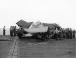 FM-1 aircraft having crashed into several TBF aircraft while landing on the flight deck of USS Coral Sea, 11 Oct 1943, photo 3 of 3
