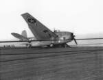 Damaged TBF Avenger aboard USS Coral Sea, 14 Oct 1943; it had crashed into a line of TBF aircraft during landing three days prior