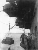 Loading stores on No. 5 sponson aboard USS Coral Sea, 6 May 1944