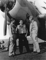 Aviation Radioman 1st Class E. L. Feehan, Aviation Ordnanceman 2nd Class S. J. Pocotny, and Lieutenant Commander J. J. Lynch aboard USS Coral Sea, 30 Oct 1943