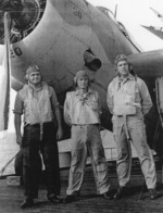 Aviation Radioman 2nd Class S. Bleier, Aviation Ordnanceman 2nd Class H. R. Thompson, and Lieutenant R. S. Evarts aboard USS Coral Sea, 30 Oct 1943