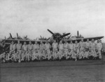 Group portrait of airmen with a FM-1 Wildcat fighter aboard USS Coral Sea, 30 Oct 1943