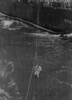 Lieutenant (jg) E. S. Taylor being transferred from USS Murray to USS Coral Sea, 30 Jan 1944