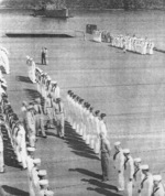 Captain Paul W. Watson of USS Coral Sea inspecting the S Division on the flight deck, 27 May 1944