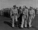 Captain George C. Montgomery inspecting USS Anzio, 16 Dec 1944, photo 1 of 2