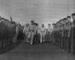 Captain George C. Montgomery inspecting USS Anzio, 16 Dec 1944, photo 2 of 2