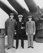 Lieutenant George Elsey, Captain James Vardaman, and Warrant Officer Edwin Hoying aboard USS Augusta, 7 Aug 1945
