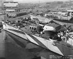 Baltimore overhauled at Mare Island Navy Yard, 21 Oct 1944, cruiser Indianapolis in background