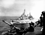British cruiser HMS Belfast alongside American light carrier USS Bataan off the coast of Korea, 27 May 1952; note Bataan
