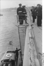 Commissioning ceremony of German battleship Bismarck, 24 Aug 1940, photo 02 of 10; Captain Ernst Lindemann coming aboard