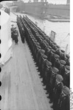 Commissioning ceremony of German battleship Bismarck, 24 Aug 1940, photo 04 of 10; Captain Ernst Lindemann reviewing crew