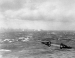 Battleship Bismarck burning in the distance as seen from a British warship, 27 May 1941