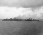 USS Blue and USS Patternson removing the crew from the fatally damaged Canberra 9 Aug 1942