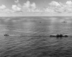 Canberra and Houston being towed by USS Munsee and USS Pawnee toward Ulithi, Caroline Islands, Oct 1944