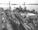 Destroyer Killen, heavy cruiser Canberra, and destroyer Claxton being repaired in floating drydock USS ABSD-2, Manus, Admiralty Islands, 2 Dec 1944