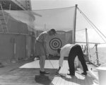 Eisenhower practicing golf aboard USS Canberra while en route to Bermuda, 14 Mar 1957