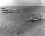 Louisville, Salt Lake City, Northampton, and Chicago turning in formation with three other Scouting Force heavy cruisers to create a slick for landing seaplanes, off Pearl Harbor, Hawaii, 31 Jan 1933