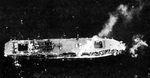 Aerial photo of Chuyo while dead in the water after torpedo hit, morning of 4 Dec 1943; note collapsed forward flight deck